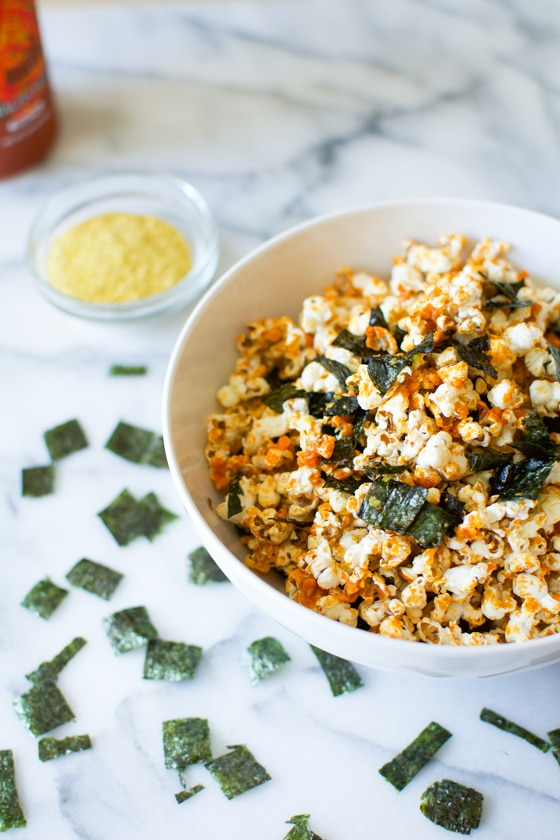 In just 5 minutes, you can create a healthy, delicious snack full of nutrients. Coconut oil sriracha popcorn with nori is salty and spicy with lots of umami. SO good and good for you!| rootandrevel.com