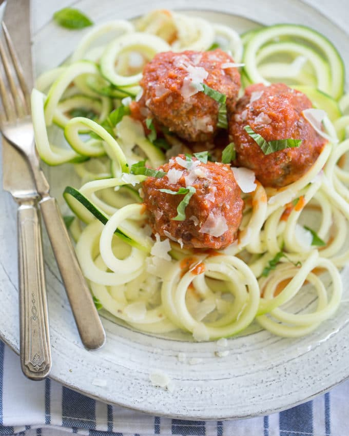 Caroline Potter, author of All-American Paleo Table, shares her story and recipe for Paleo spaghetti and meatballs. Grain-free and refined sugar-free. | rootandrevel.com