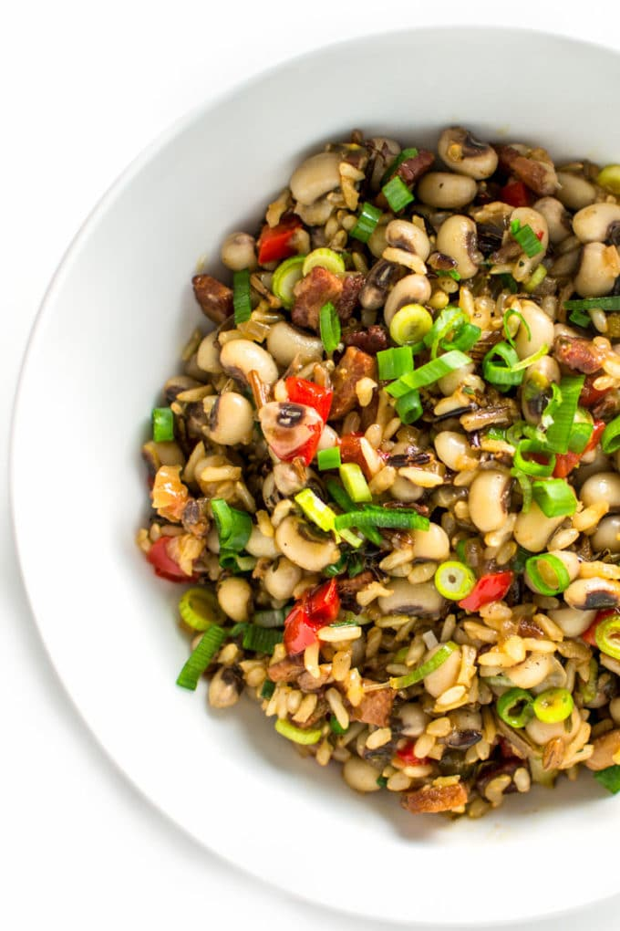 The classic Southern dish of Hoppin' John gets a colorful and nutritious boost from peppers, scallions and whole grain wild rice. Gluten-free and DELICIOUS! | rootandrevel.com