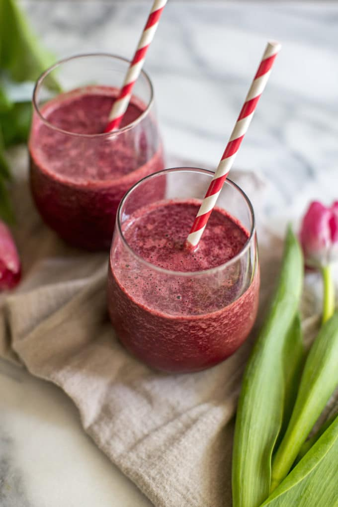This nourishing Red Velvet Green Smoothie with beets is love in a glass--it tastes like cake, but is chockfull of vitamins + minerals. Vegan + gluten-free! | rootandrevel.com
