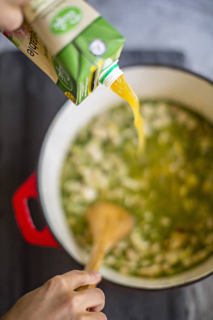 In just 15 minutes, this quick + easy salsa verde chicken soup with white beans comes together for a fresh and healthy bowl full of flavor and nutrients! | rootandrevel.com