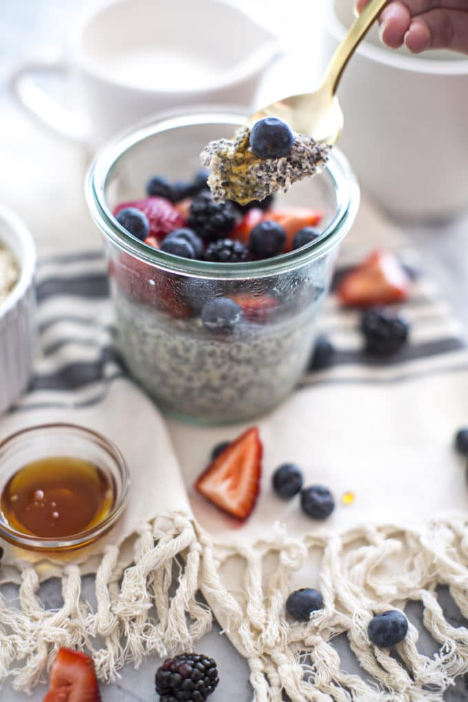 This overnight oatmeal chia pudding recipe is spiked with vanilla, honey and berries for a healthy and easy make-ahead breakfast full of protein, fiber and omega-3s. Vegan (made with almond milk), gluten-free and delicious, this refrigerator oatmeal is made in a jar and eaten cold for a fresh way to start your day!