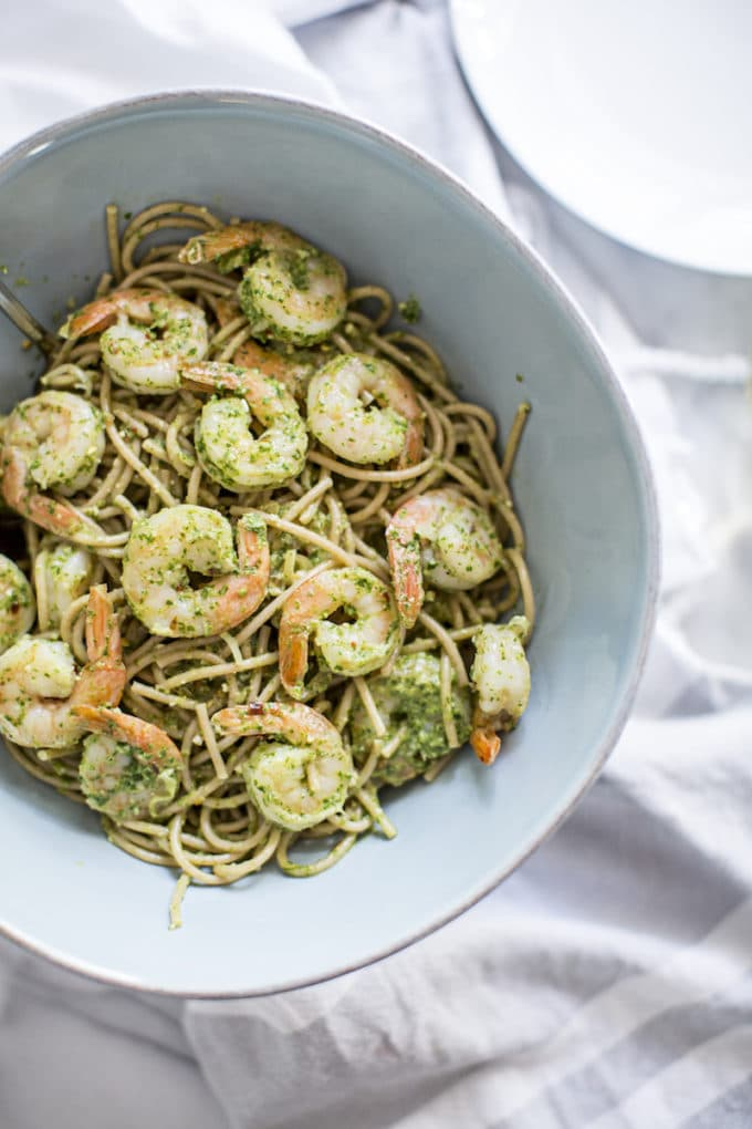 This easy shrimp pasta with pesto is a healthy twist on shrimp scampi, bursting with seafood, garlic, olive oil and a lemon-white wine sauce. Made gluten-free with GF spaghetti or zoodles, it's bright and tangy, perfect for lazy summer evenings.