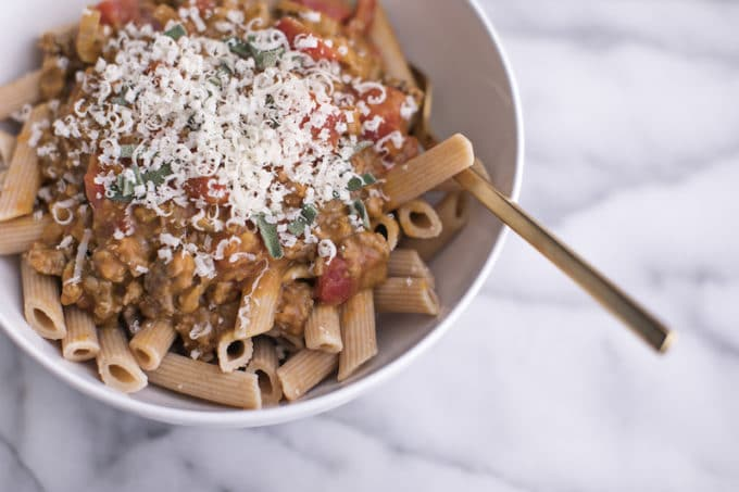 This easy pumpkin bolognese pasta sauce recipe is super healthy and bursting with cozy Fall flavors. Made with mushrooms and grass-fed ground beef, serve this delicious pumpkin pasta sauce over gluten-free penne for a nutritious dinner the whole family will love.