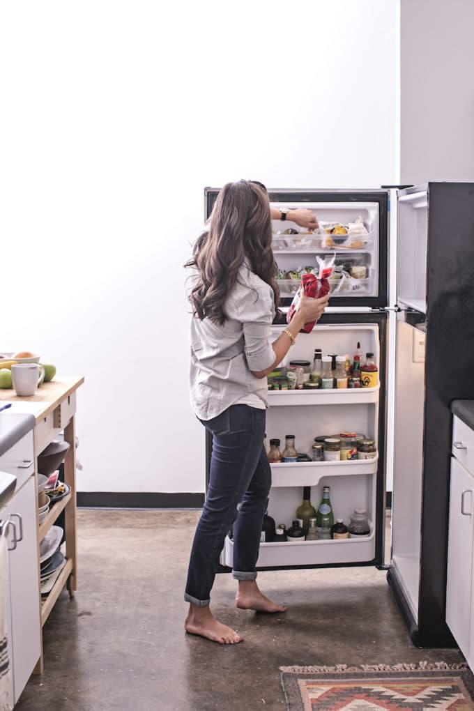 Keeping your fridge stocked with real, whole, anti-inflammatory foods makes healthy eating easy! Here's a peek of what's in my fridge, complete with a handy real food shopping list you can take with you to the grocery store.