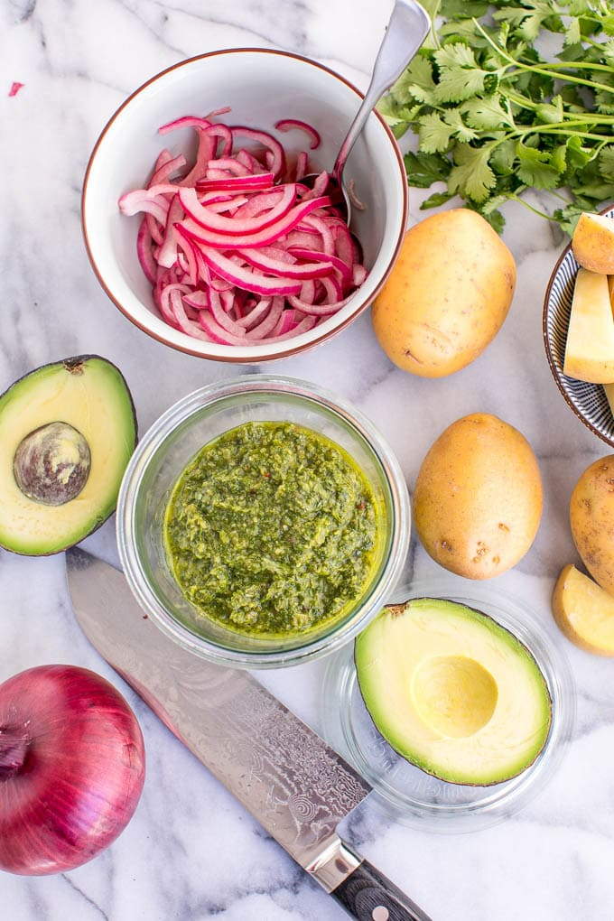 Using a classic Argentina chimichurri sauce, this recipe for chimichurri steak bowls is an easy, healthy dinner served up in a bowl with roasted potatoes, avocados and pickled red onions.