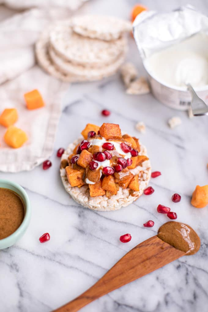 SEASONAL WINTER FOOD: Pomegranates  - Rice Cakes with almond butter, pomegranates and butternut squash