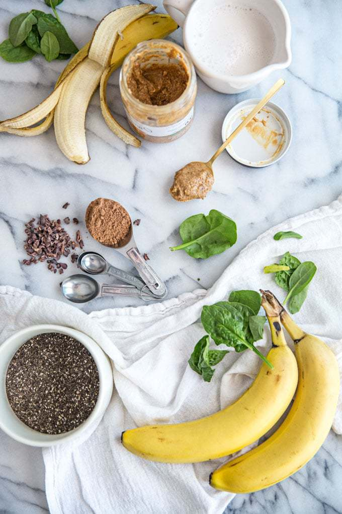 Named for Elvis, this healthy peanut butter and banana green smoothie is a low-calorie, Paleo protein shake perfect for breakfast, dessert or a snack. Made with chocolate (cacao) for an indulgent twist.