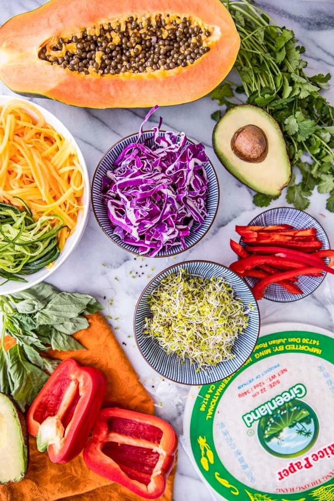 These healthy Rainbow Spring Rolls with a spicy Vietnamese peanut sauce are a colorful vegetarian recipe perfect for Spring's fresh veggie bounty.