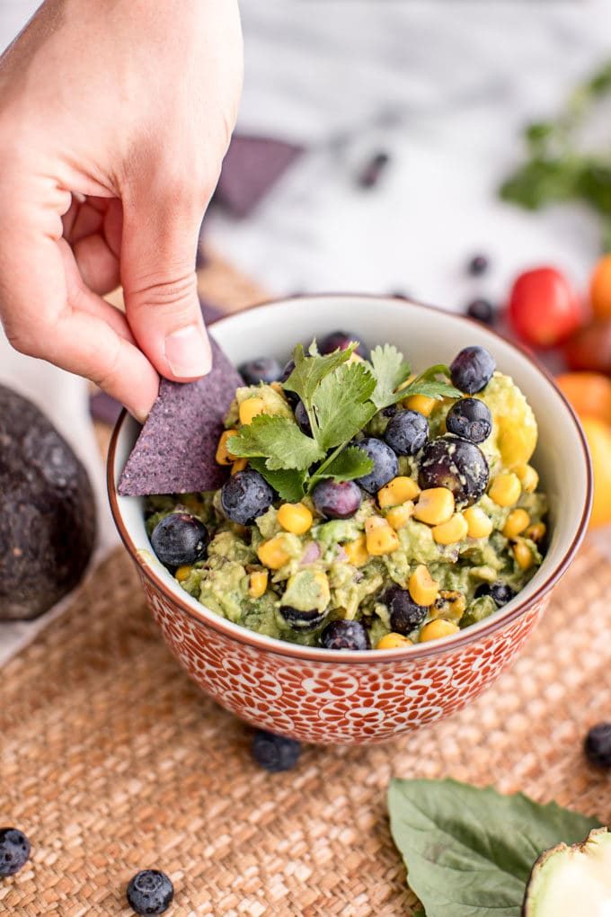 Blueberries aren't just for breakfast and dessert--this savory blueberry recipe will send your taste buds soaring. Blueberry guacamole is spiked with sweet corn, heirloom tomatoes and lots of zesty spices!