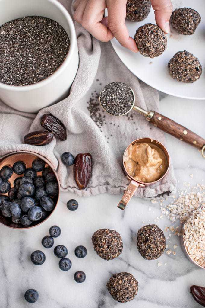 What are chia seeds and what makes them a 'superfood'? Find out the top five health benefits of chia seeds plus six tips for how to get them into your diet, including recipes! Blueberry Energy Balls