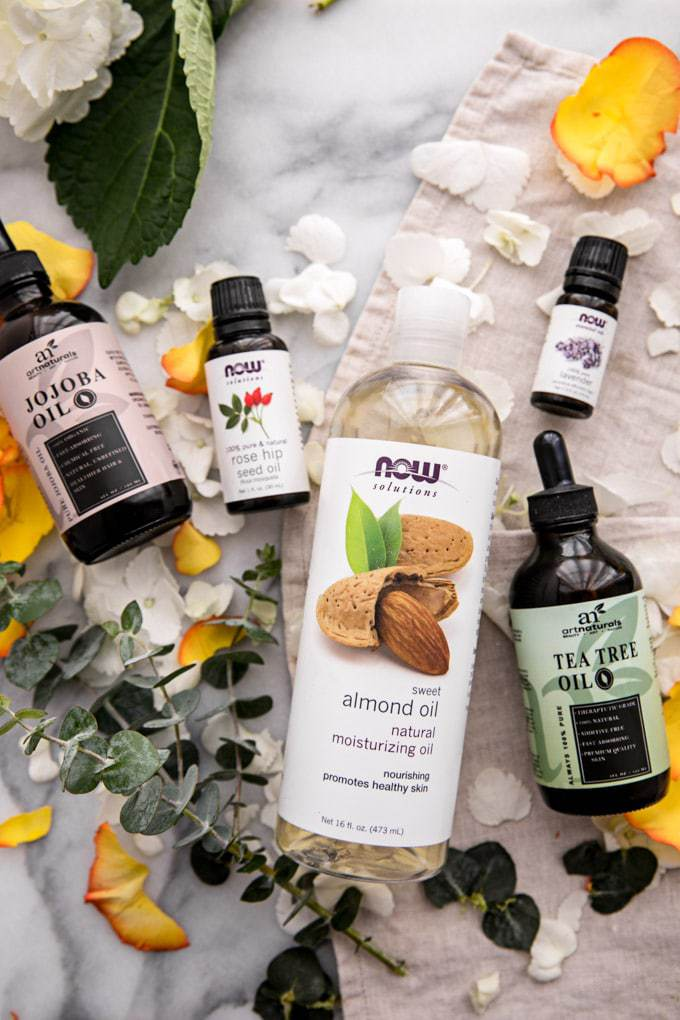 This Custom DIY Homemade Face Oil recipe is a natural, nontoxic and inexpensive skincare multi-tasker (moisturizer, cleanser, serum) can be tailored to all skin types (oily/acne-prone, dry, sensitive, mature), making it the perfect Mother's Day gift idea. Learn which carrier oils and essentials oils are best for your skin here!