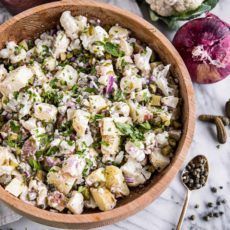 This easy Paleo cauliflower potato salad is low-carb and healthy, yet creamy and absolutely delicious thanks to the addictive tang from the pickles, capers and mustard. Use only cauliflower for a faux-tato salad that's just as tasty and also Keto compliant.