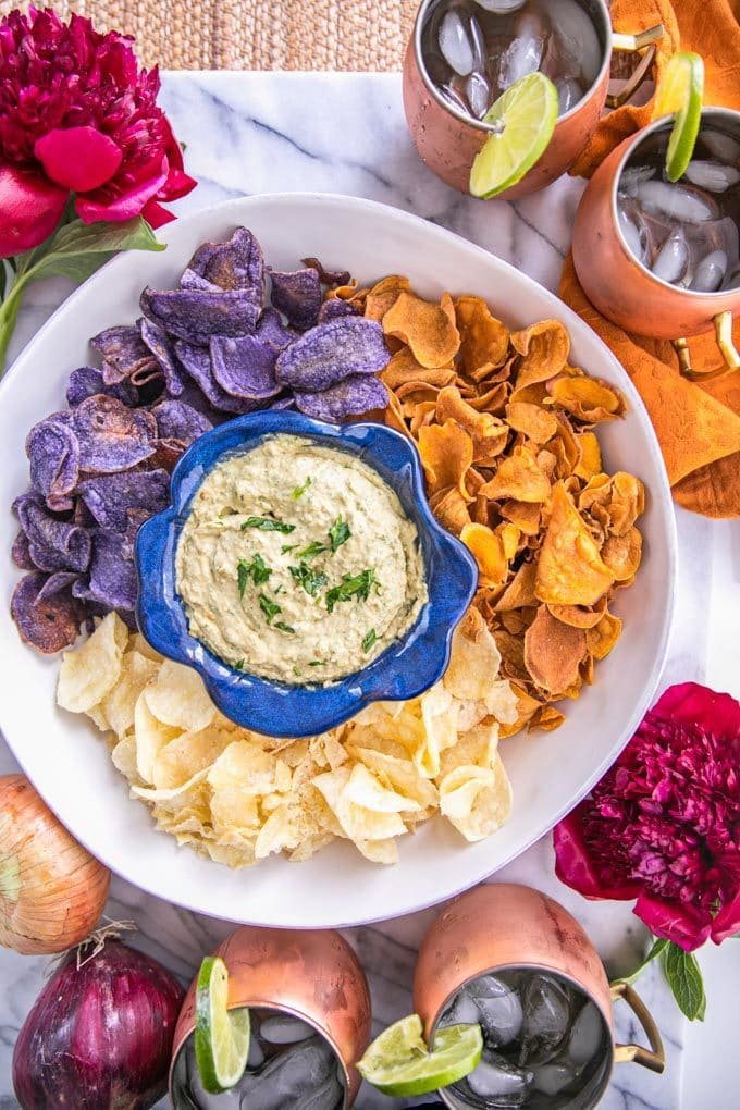 Looking for the perfect party appetizer? This lactose-free French Onion Dip recipe is easy, delicious and full of Vitamin A + K. Serve with healthy chips from Jackson's Honest, low-heat fried in organic coconut oil.