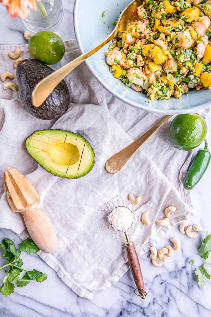 This easy and healthy Thai Coconut Shrimp Ceviche Recipe is made with juicy mango and avocado salsa for the best spicy summer salad. Paleo and gluten-free, too!