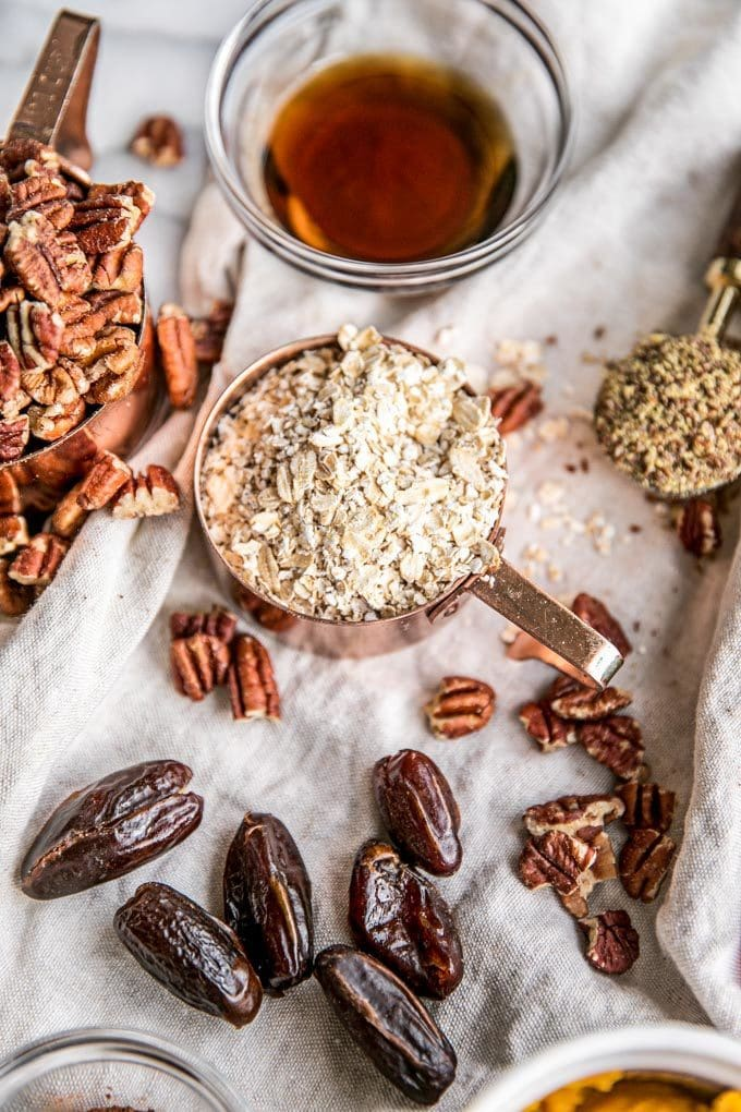 No Bake Energy Balls + Pumpkin Pie Protein Bites: clean eating recipe filled with pumpkin, dates, oats, flax seed, pecans, almond butter, maple syrup