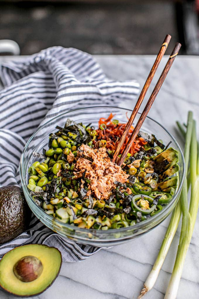 "Do you love sushi? Then you'll LOVE these spicy tuna ""poke"" bowls! This healthy homemade recipe is made with canned tuna (instead of raw Hawaiian ahi) for easy prep, and it's bursting with delicious Asian flavors like spicy wasabi mayo, sweet eel sauce, pickled veggies, whole grain rice, avocado and umami-rich seaweed. Plus, it's so good for you--high in protein, fiber, healthy fats and nearly every nutrient imaginable. Gluten-free, too! Lunch just got a lot more exciting!"