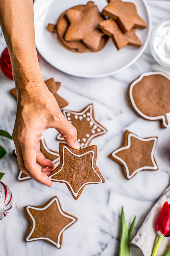 gingerbread cookies shaped in stars scattered over a table