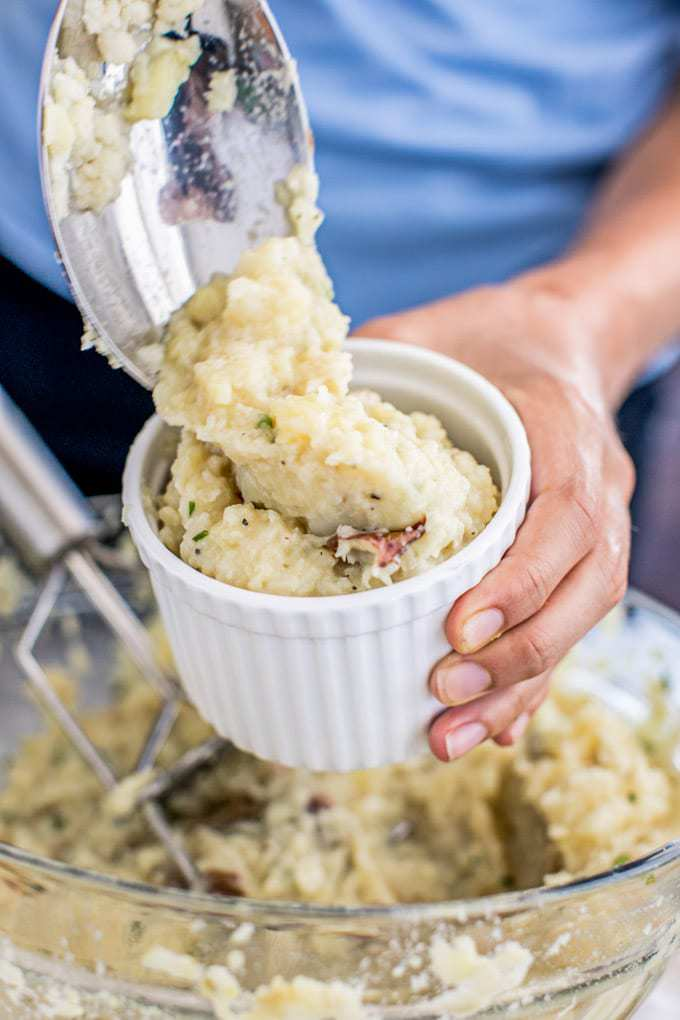 Wondering how to make instant pot mashed potatoes? Not only is this mashed potato recipe dairy free (vegan-friendly) and Paleo, but it's also super easy to make and bursting with flavor like sweet roasted garlic, nutty nutritional yeast and bright chives. And it's beyond creamy thanks to cauliflower, olive oil and cashew milk! Even better--these mashed potatoes are low fat, high in fiber and collagen protein, and chockfull of Vitamin C, B and K. The best comfort food!