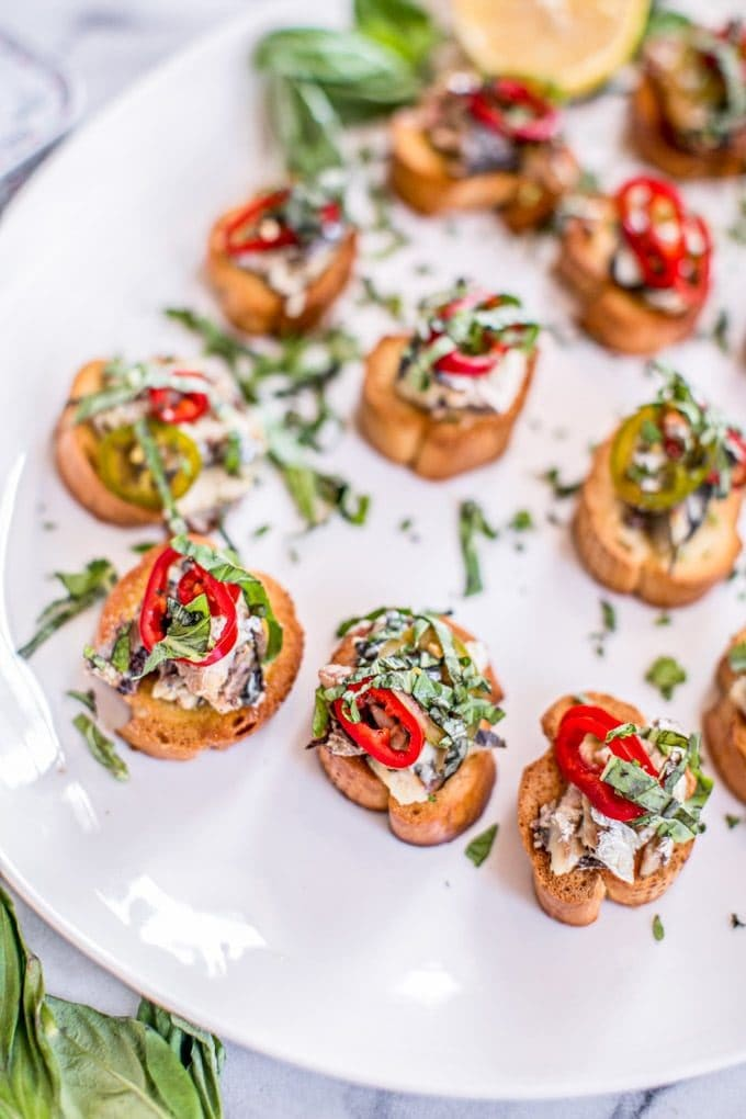 Looking for an easy + healthy appetizer recipe? This bright and tangy crostini is made with canned sardines, sherry pickled chiles and fresh herbs. Can swap in gluten-freeor Paleo bread or crackers, if needed.