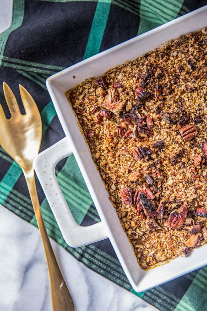 This healthy sweet potato casserole recipe is made with pecans and canned sweet potato for an easy Thanksgiving side dish or dessert. Dairy-free and gluten free, this vegan-friendly sweet potato casserole is creamy and decadent, and yet guilt-free thanks to ghee (can swap coconut oil if vegan), coconut milk and maple syrup (read: refined sugar-free too!).