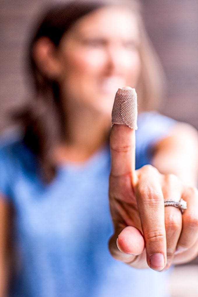 Finger wrapped in a band-aid.