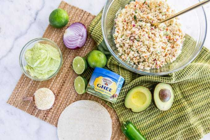 Crispy, crunchy and savory baja fish tacos that are also healthy and gluten free? Yes! It IS possible to make lightened up, real food fried tacos that make for a perfect summer meal. In this recipe, we'll show you how it's done, complete easy-to-make withAvocado Crema sauce + Chipotle Coleslaw.