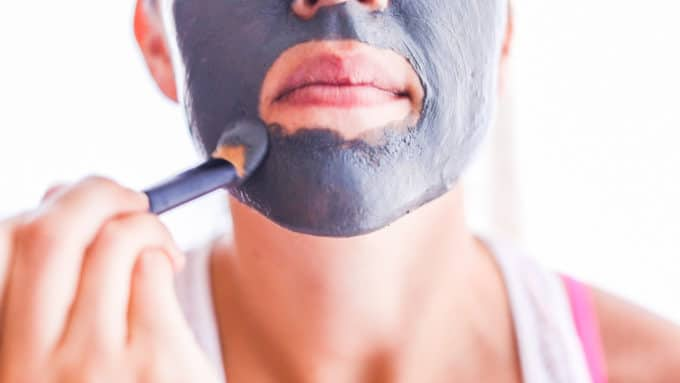 Using a charcoal DIY mask is a beneficial self-care idea.