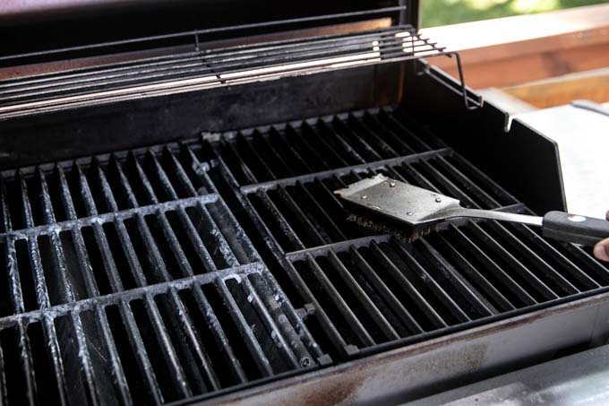 This quick and easy non-toxic DIY Grill Cleaner is a must during summer!  Homemade grill cleaner is not only safer and cheaper, but also makes a perfect Father's Day gift. You just need four natural ingredients, no harmful ammonia, to cleanse your grill grates, improve taste, reduce gas expenses and prevent rust!