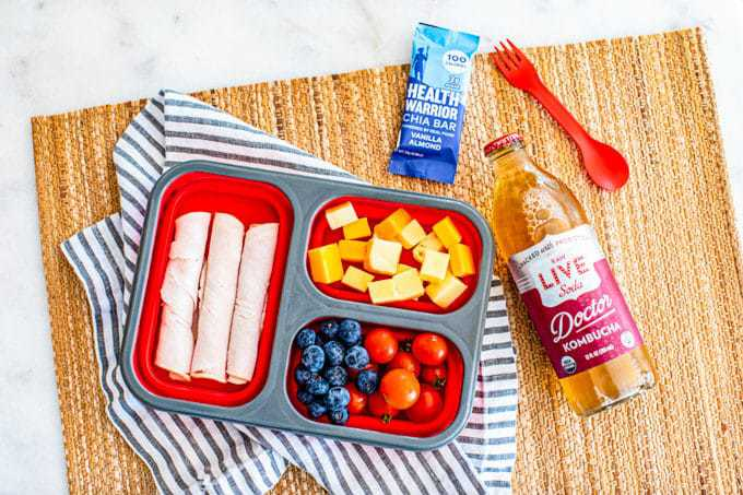 Healthy Lunchbox Ideas for Kids: healthy lunchmeat, grass-fed cheese, fruit, veggies, Health Warrior Chia Bar, Kombucha