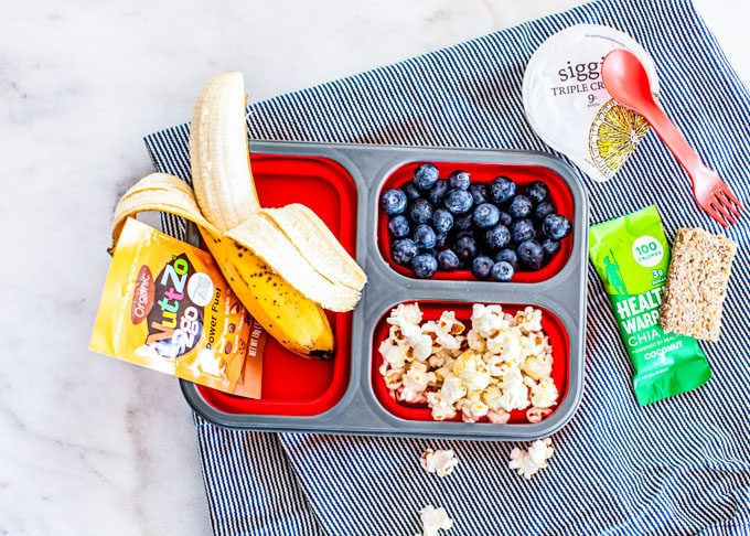 Healthy Lunchbox Ideas for Kids: banana, berries, popcorn, nut butter, yogurt, chia seed bar