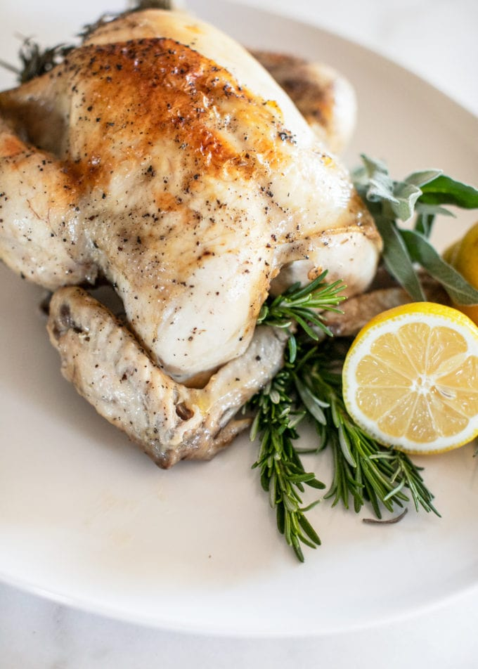 Think cooking a whole chicken is hard or time-consuming? Think again! It's never been simpler with this Easy Instant Pot Whole Chicken recipe that is super quick, yet still results in a moist, crispy bird in just one hour. Bursting with fresh herbs, lemon and garlic, this meal is a perfectly healthy dinner for the whole family that's also keto, paleo and Whole30!