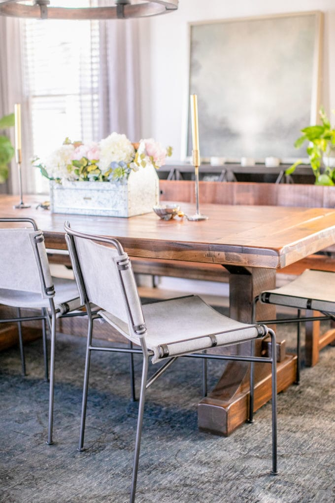 Looking for ideas and inspiration for a modern farmhouse dining room? I channeled my inner Joanna Gaines to design this rustic, modern industrial dining room, complete with reclaimed wood dining table, antique fireplace, a round lantern chandelier and plenty of black iron details.
