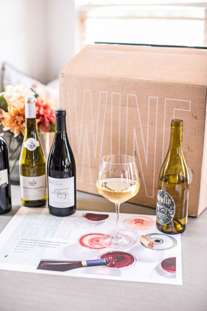 A box of wine and wine bottles on a table