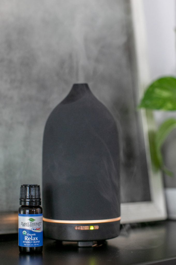 Black essential oil diffuser on a table top
