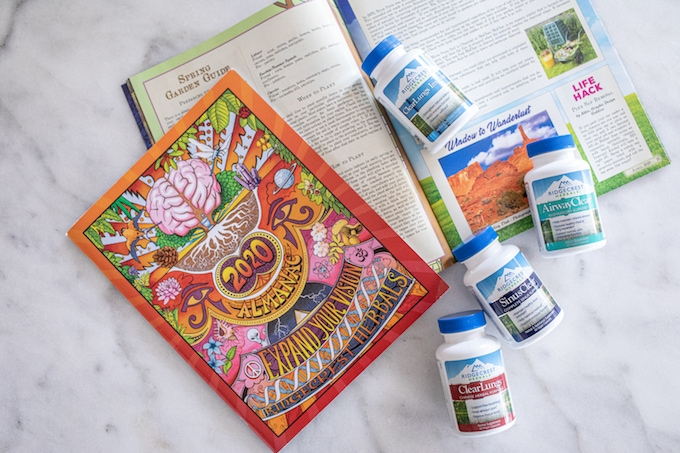 Ridgecrest Herbals supplements on a table with a 2020 Almanac.