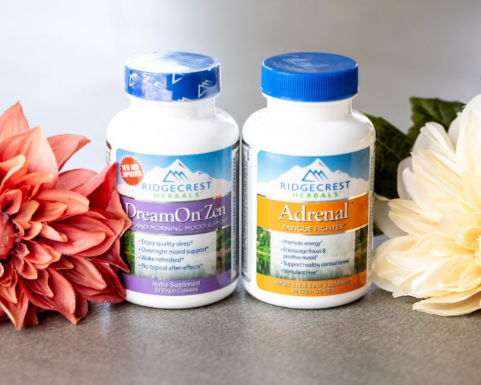 Ridgecrest Herbals DreamOn and Adrenals bottles on a table with flowers