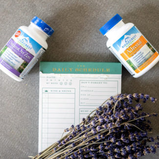 Two bottles of Ridgecrest Herbals' supplements with lavender and a daily schedule