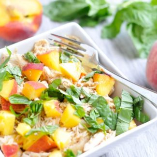Peaches, chicken and basil in a bowl